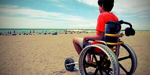kid-in-a-wheelchair-on-the-beach