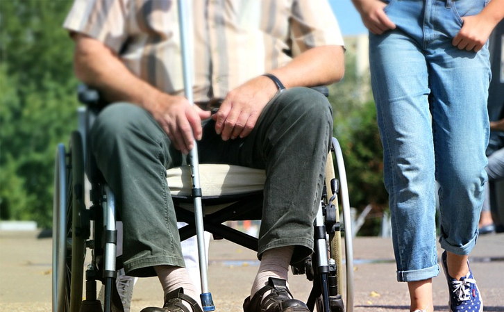 Man-in-Wheelchair-With-Cane-Because-Hemiplegia
