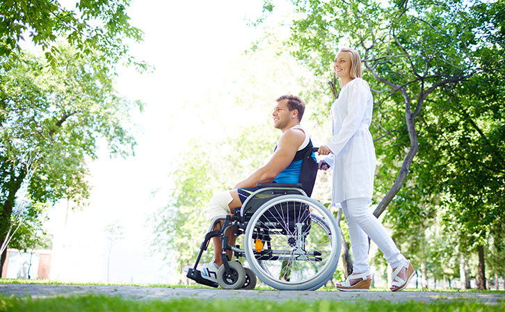 Nurse-Walking-With-Patient-During-Paraplegic-Recovery