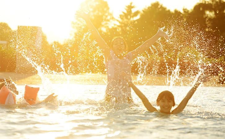 people bathing in warm water