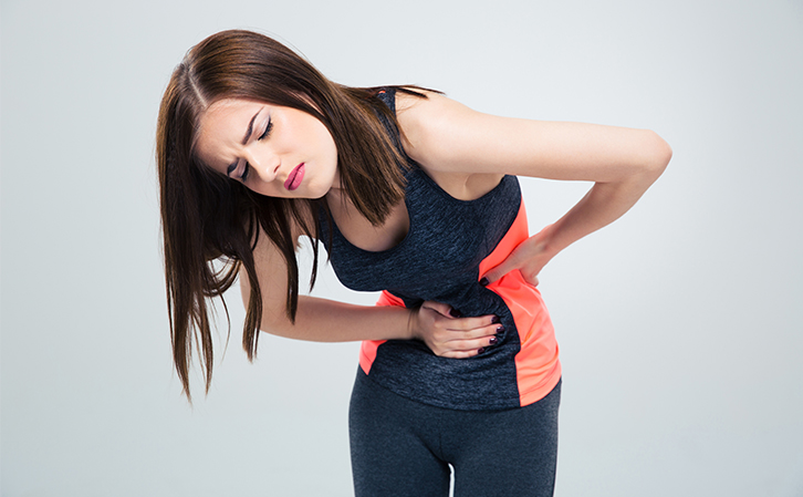 woman having muscle spasms